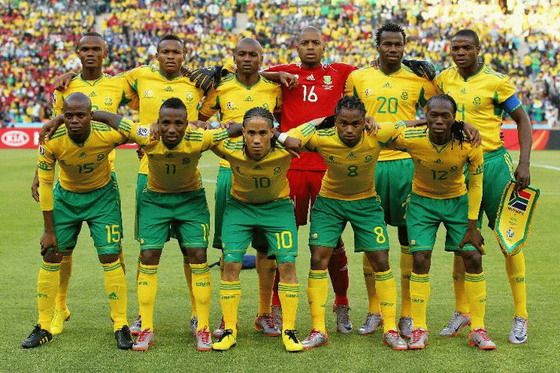 Trait: Sports  In this photo we see the South African male soccer team. In South Africa soccer is the most popular sport. In 2010, South Africa hosted the first ever World Cup in South Africa