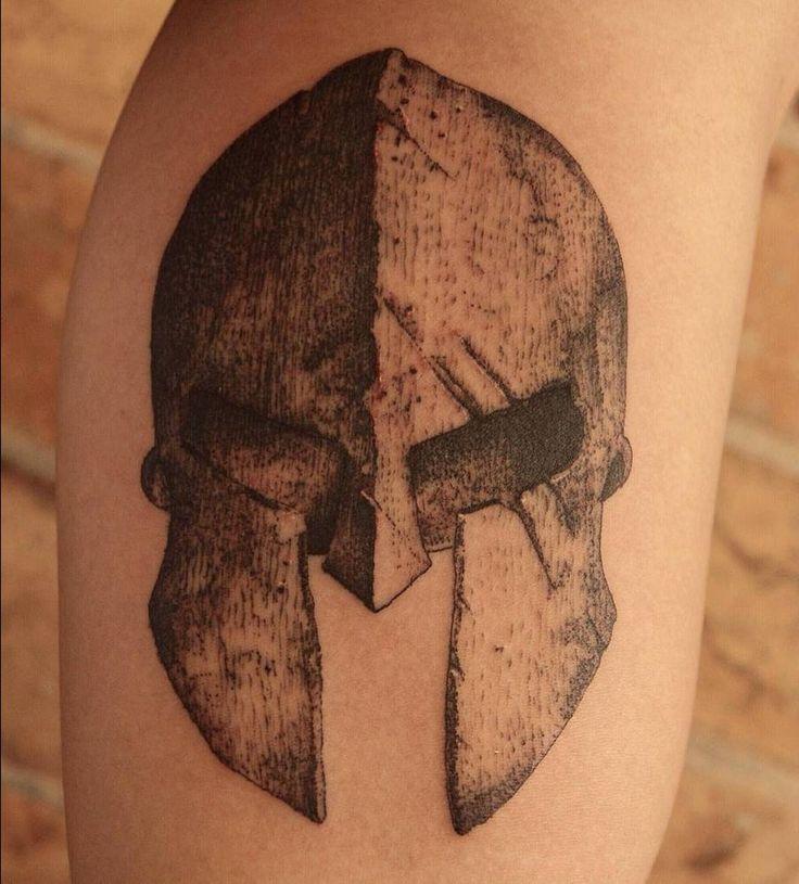 Spartan helmet tattoo on the calf.