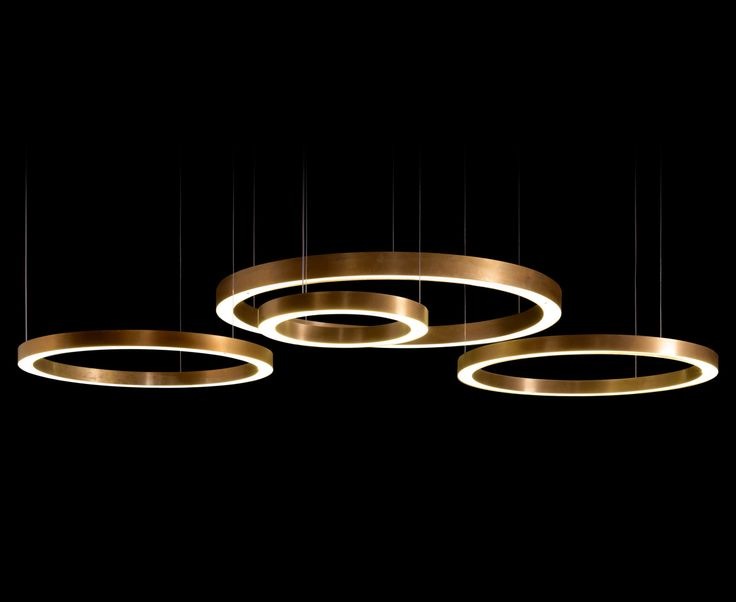 LEGIO - Light: Henge Pendant energy saving led (energy efficiency index A) lamp with warm light, formed with rings of various sizes and types of illumination; incorporating transformers in the ceiling rosette, low voltage power supply to the rings through the suspension cables. Standard overall height 180 cm. Finish H-Silver®: pure 99.9% silver on brass, burnished by hand using …