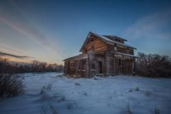 an old homestead in saskatchewan during the blue hour