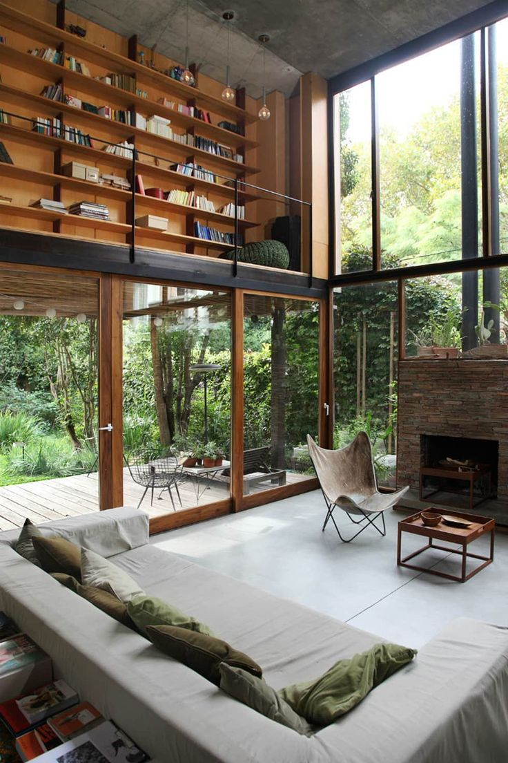 Spacious living room with abundant line from the large windows and a mezzanine library in this