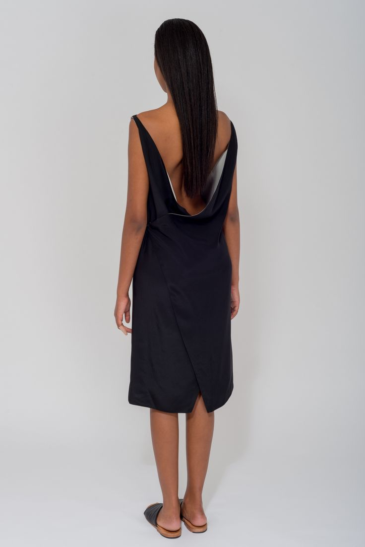 Crafted from fluid and incredibly soft matte sand-washed silk wrap-effect  Dress is cut with a flattering loose drape through the back.  Making it the  perfect piece to transition from desk to dinner. Scalene dress is a  versatile addition to your wardrobe as it is fully reversible and can be  worn, back to front.     - 4 ways to wear  - Black with Grey Linning  - Hook & eye closure  - 100% Silk  - Australian Made  - Dry clean