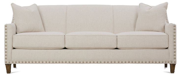 Elevated on kiln-dried hardwood legs, this queen-size sleeper sofa shows off a neutral hue and swooping arms traced in sleek, oversize pewter nailheads. A high-resiliency foam-and-fiber fill and...