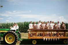 I love this photo of the bridal party on a tractor.