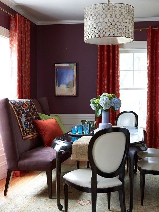 Deep Plum Walls In Dining Room With Red Curtains