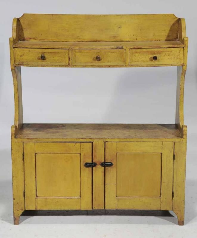 Cabinet attributed to Lebanon County, Pennsylvania, circa 1830-1840, poplar throughout and retaining original yellow paint over red wash, three dovetailed drawers with faceted fronts over two paneled cabinet doors, 52 x 43-1/4 x 15 in. - See more at: