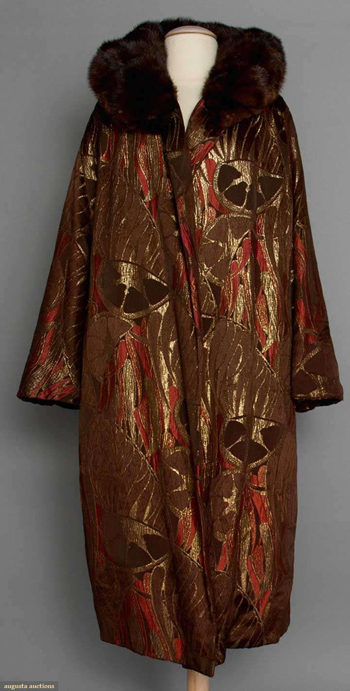 "BROWN SILK & LAME COAT, 1920s Chocolate brown & coral silk w/ gold lame in unusual abstract patterns, chocolate brown velvet lining, mink collar, 3/4 length bell sleeves, labeled ""Bonwit Teller & Co. Fifth Avenue New York"", L 46"", excellent."