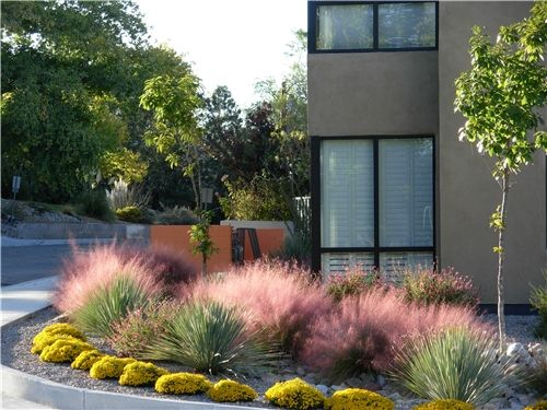 Stunning Southwest landscaping by Quercus (David Cristiani). Not only does it reflect the beauty of his region, but it's unique and artful as well. Check out David's tips for landscaping in the Southwest here: http://www.landscapingnetwork.com/garden-styles/southwest.html