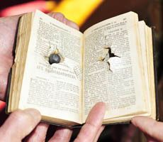 Bible with bullet hole