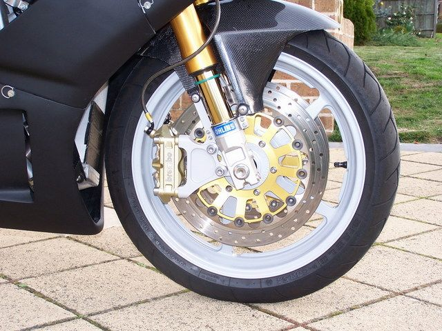 Custom Radial Conversion Adaptors to suit the older style FG43 Ohlins forks.: Custom Radial Brake Adaptor