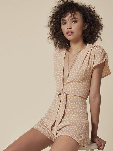Just a quick knot and you're out the door. This is a relaxed fitting, short jumpsuit with a center front tie and cut out.