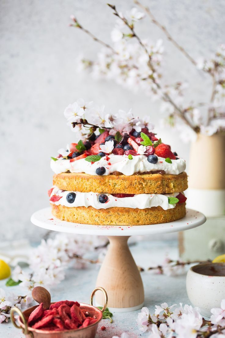 Can't get over this easy cake made from scratch!!! This Berries and Cream Cake recipe with Strawberry Rhubarb Marmalade is a gorgeous tiered cake perfect for making on rainy spring days. It's topped with fresh whipped cream and berries.
