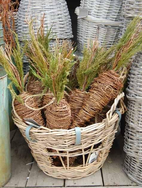 How great these would be near a front door during Easter......Twine carrots, cute.