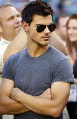 Taylor Lautner.Oh he is really hot.Please check out my website thanks. www.photopix.co.nz