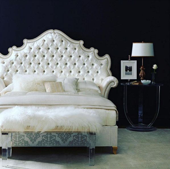 Talk about a statement headboard! Contrasting white tufted headboard and dark walls | Horchow