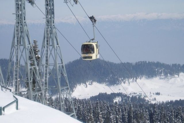 (panoramio.com) World's Most Extreme Holiday Activities: Go up in the world's highest gondola lift in Kashmir-Take a trip on the highest cable car in the world, located in Kashmir. The lift provides the easiest way to reach one of the highest points on Earth without a rope! The Gulmarg Gondola is Asia's highest and longest cable car project. The two-stage ropeway ferries about 600 people per hour to and from Kongdoori Mountain, a shoulder of nearby Afarwat Peak (4,200m (13,780ft)). The…