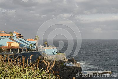 Resort hotels by a rocky beach in Canico de Baixo, Madeira, Portugal . Hotels Oasis Atlantic