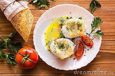Sandwiches with poached egg, tomato, parsley and cheese. Top view
