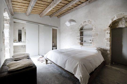 A 19th century palmento (wine press) transformed into a stunning villa, near Noto, Sicily   bedroom