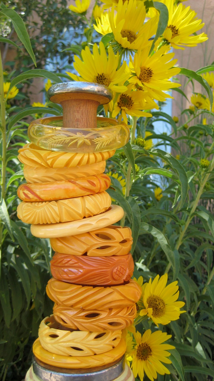 Gorgeous stack of Bakelite bangles.