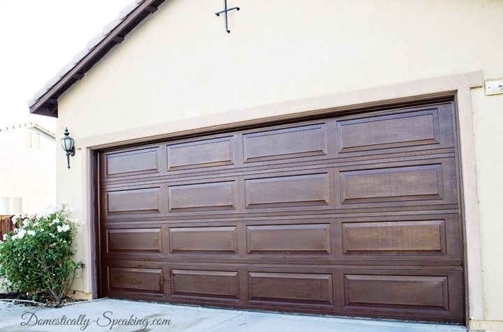 Faux Wood Garage Door Update with Stain minwax's walnut gel stain. One quart of stain and one coat.