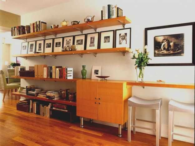 wall shelves displaying photographs