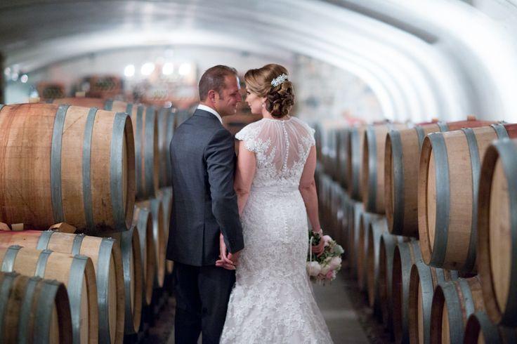 Vineland Estates bride and groom wine barrels