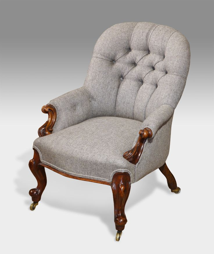Small Victorian upholstered arm chair. Shaped button back and stuffover seat with beautifully carved walnut arm rests and cabriole feet. Raised on brass castors. Upholstered in a fine herringbone tweed by Ardalanish, Isle of Mull.  circa. 1840 £1,350