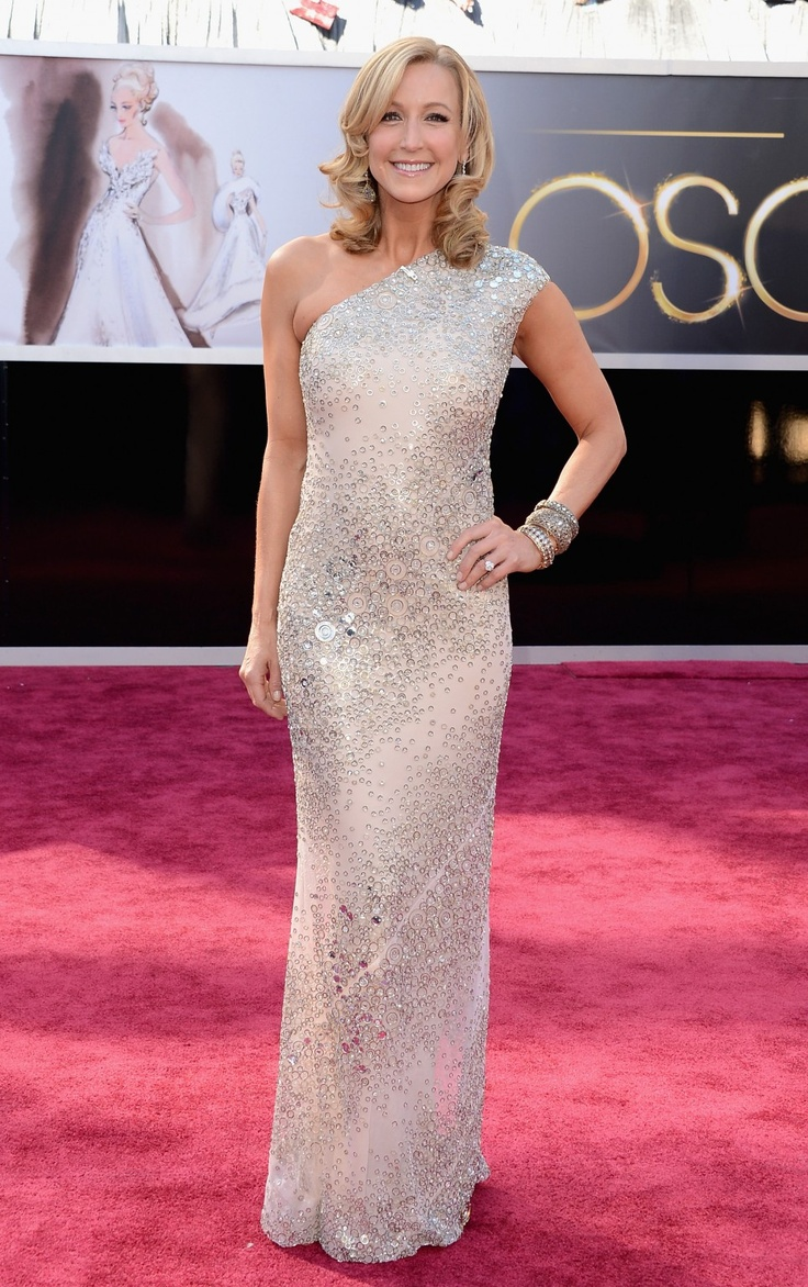 Lara Spencer in Kaufman Franco..beautiful dress. For the perfect look would have to put the bracelets on her right arm and make hair gathered up.