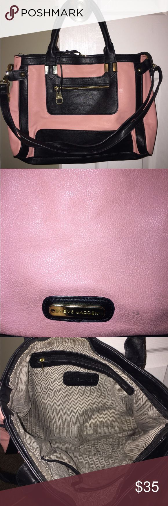 Medium sized Steve Madden bag Salmon colored mid sized Steve Madden bag. Zipper on the front is great for keeping your keys in or for putting makeup. Good sized bag. I used it for work and would carry an iPad and binders in it. Still has a lot of life left. Handles do show some wear to them. See last 3 pictures. Steve Madden Bags