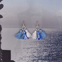These fresh air blue tassel fan earrings with give your look a vintage, Mediterranean feel.  Metal and cotton.  Made in Italy.