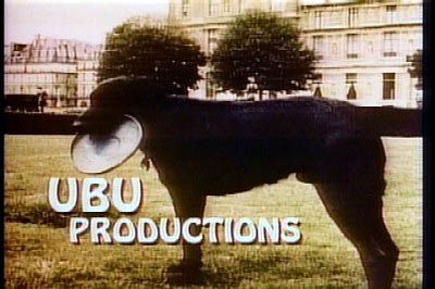 """sit, Ubu, sit.... Good boy."" - UBU prod. started in 1981 by Gary David Goldberg.  You could see it at the end of Family Ties (1982-89) - Ubu was Goldbergs dog that he travelled with.  This was taken in France."