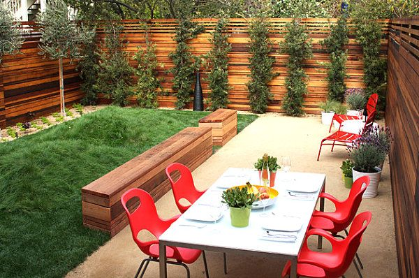 The Art of a Small Yard Landscape - modern and comfortable and I love the pop of color THIS FENCE!