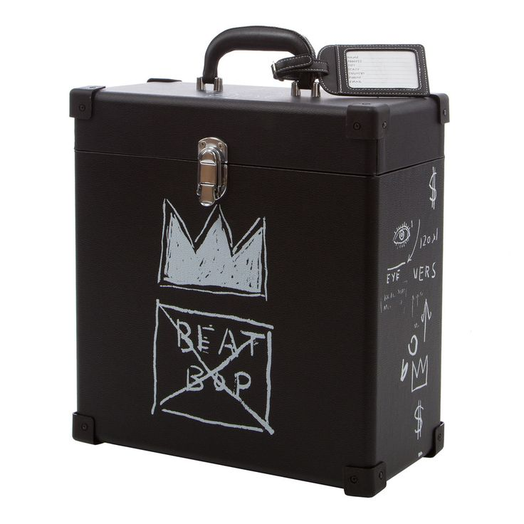 "This Beat Bop Record Box includes officially licensed artwork from Jean-Michel Basquiat on a premium record carrying case. Only 1,000 of the record carry case exist and will never be produced again after this run. <br /> <br />Holding up to 50 records, this ultra-sturdy record case, with an interior tiled with Basquiat's famous crown logo, is a true and literal work of art, covered in classic images from the original Tartown Records version of the 1983 classic hip-hop track ""Beat Bop .  <br…"