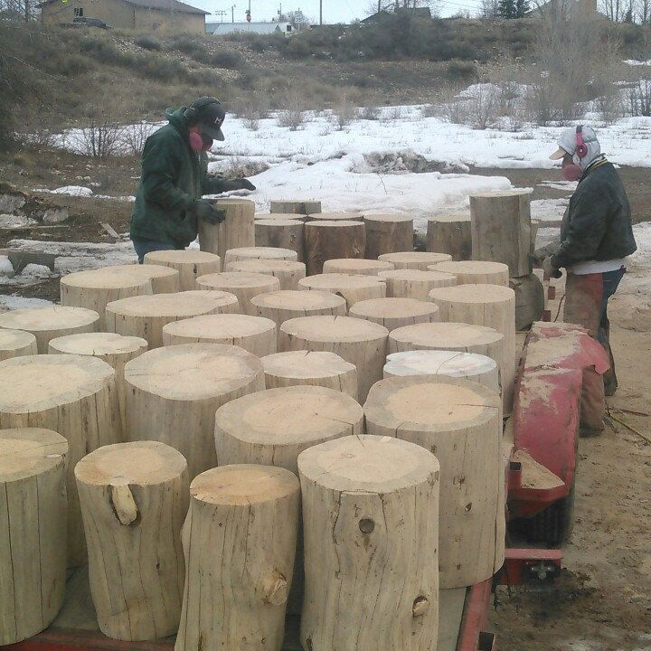 Forty log end tables being prepped for PGA tournament in Austin, TX