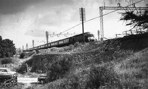 16th August 1963: Scene of the great train robbery with the train waiting on an embankment above a country road.