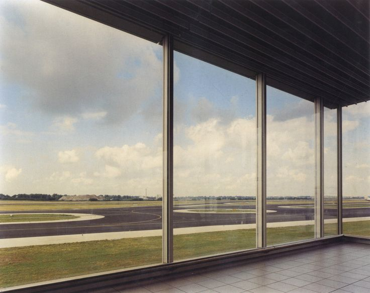 punctum:  Andreas Gursky   |   Schiphol, 1994  Schiphol is the largest airport in the Netherlands, where I live, and it looks nothing like this.