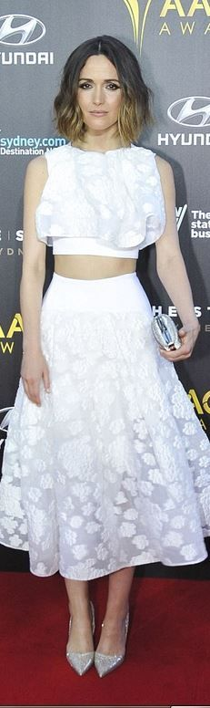 Who made Rose Byrnes's white ruffle top, skirt, purse, and silver pumps?