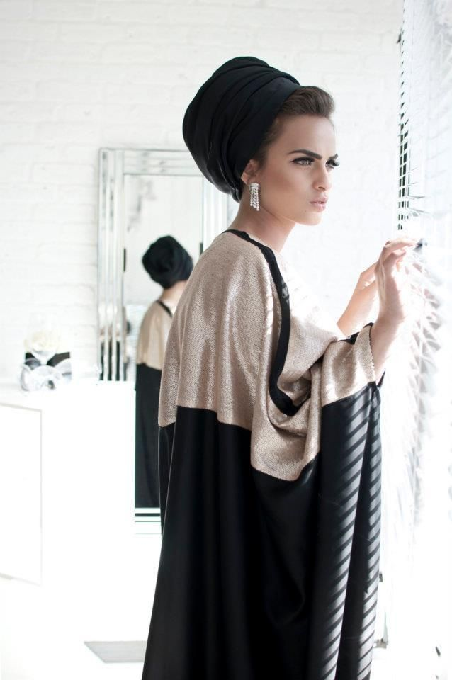 Here is a modern take on a turban or hijab which were very popular in Folk Dress. This look does not cover the face as much as the original but is derived from the Middle East.