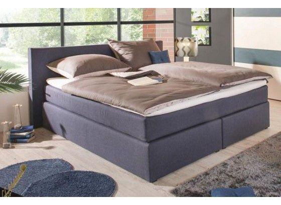Das aktuelle Boxspringbett TARVISO besticht durch einen modernen Bezug in Webstoff Petrol und sorgt für mehr Komfort im Schlafzimmer.