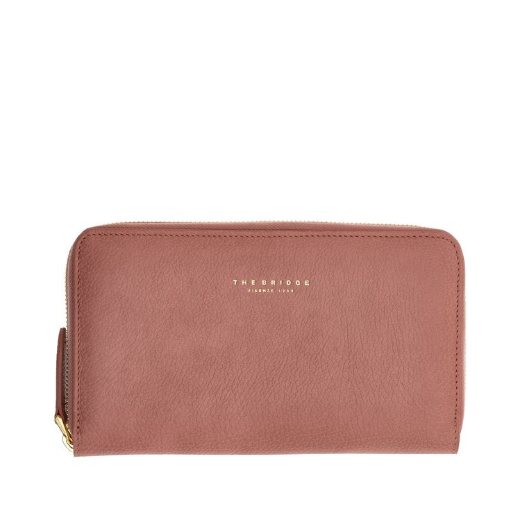 This bifold leather wallet from The Bridge is a feminine and fashionable accessory. Perfect to store safely your credit cards, bills and coins thanks to its zippered closure. Minimal and slim, this wallet features a sporty and youthful design. The perfect balance between elegance and function. Size 19X11 cm.