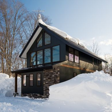 Winter Home-Serving as both a winter and summer home, this ski chalet combines modern with enough rustic to maintain a woodsy feel. Plenty of windows and an open floor plan allow for breathtaking views from most anywhere in the house. Our favorite touch? The heated bathroom floors.