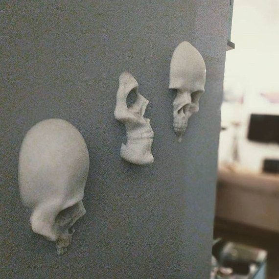 I designed these 3d wall art skulls to be used as a general awesomeness or Halloween decoration. The quantities listed here are what Ive already made and have in stock, but I can 3D print any of them to order of needed. They have a honeycomb pattern on the back to make them hang with just a