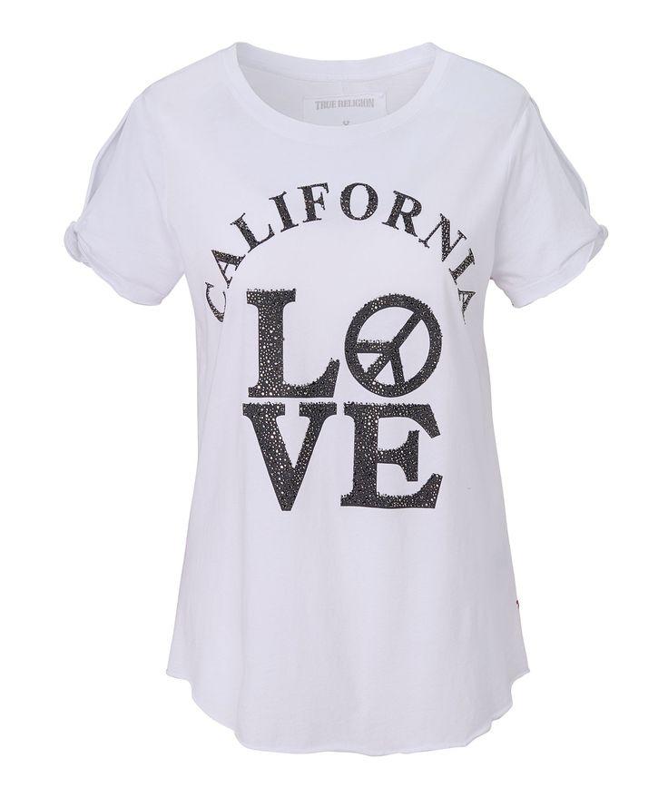 T-Shirt aus weicher Qualität. Mit Nieten besetztem Statementprint, Cut-outs am Ärmel, kleiner Logostickerei an der Seitennaht und offenen Kanten