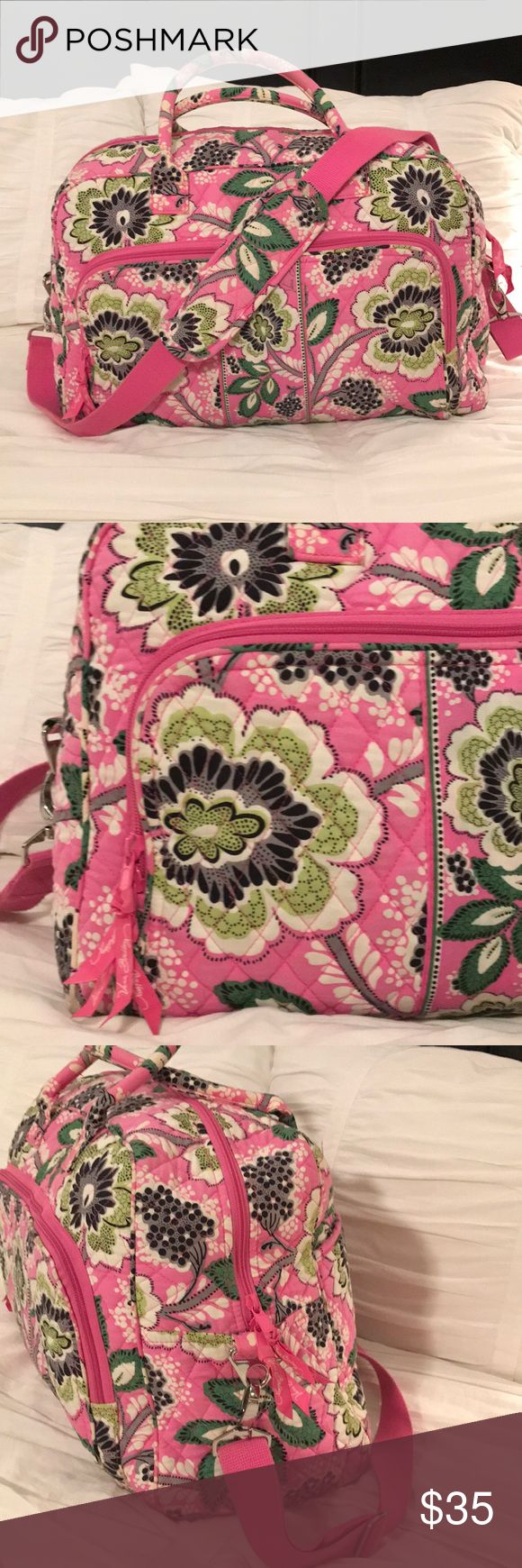 Vera Bradley Weekender Bag Perfect for short trips! Pink, green, white, gray and black paisley pattern. Detachable pink shoulder strap. Big front zip pocket, luggage attachment on back for easy carrying with a roller bag. 5 interior pockets. Lightly worn on straps (see photos), otherwise excellent condition! Vera Bradley Bags Travel Bags