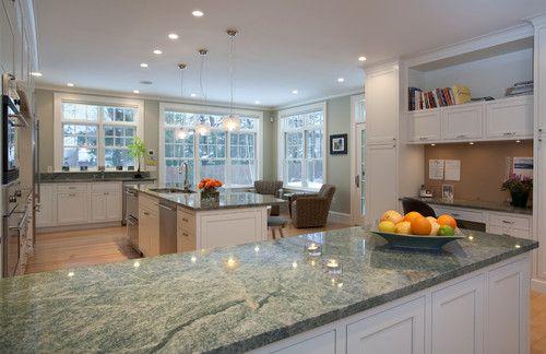 Hmmm... green granite... Costa Smeralda granite with white cabinets.