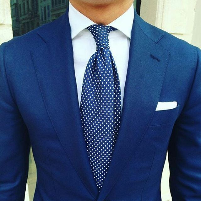 Very cool tie to go with navy suit.