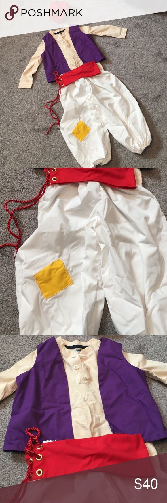 Aladdin Halloween costume Fits 3-4 year old. My son just turned 4 when he wore it. Handmade bought on etsy for $80 and worn for one hour. I am including the nude shirt from old navy that he wore under vest because it was cold that night. Pants, belt, vest, shirt and hat all included. Costumes Halloween