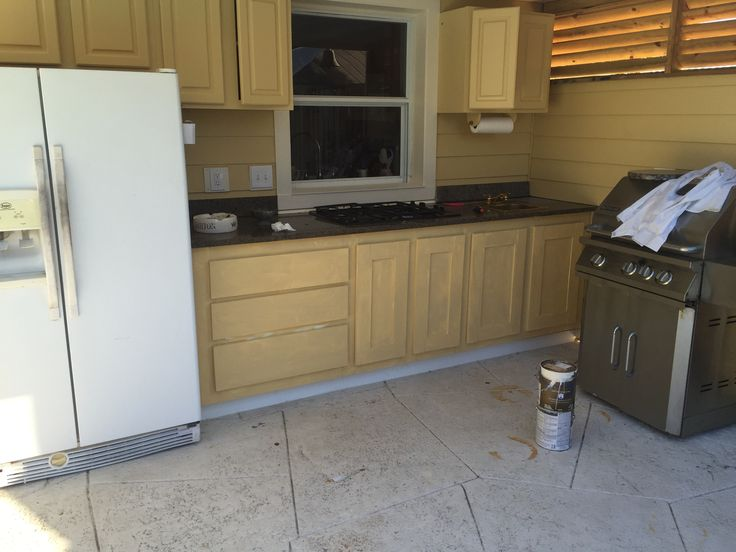 Outdoor kitchen under covered porch. Gas cooktop pvc waterproof cabinets, granite top salvaged from condo remodel. We really should put a bit more effort into staging the photos.