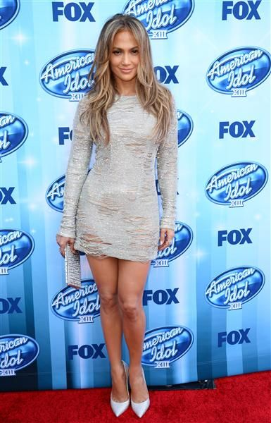 "Like every good fashion darling, Jennifer Lopez knows that if you want to show a lot of leg, don't show a lot of your arms. At the finale of last season's ""American Idol,"" the judge made quite the entrance in this glittery silver mini that she wore with her hair blown out. And get a load of those subtle rips in the dress! Like us on Facebook?"